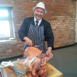 2015-04-22, Craig Whitehouse butcher, cutting Spring lamb