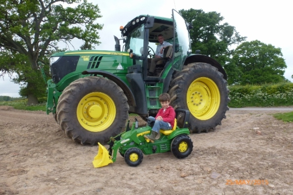 Francis & Adrian in John Deere tractors 246kb