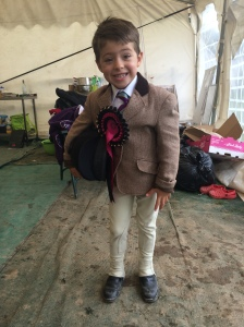 Francis (5) with rosettes at his first Junior Pony Club camp