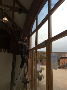 2015-07-27, Applying UV films to Apley Farm Shop windows