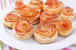 28223029-tasty-puff-pastry-with-apple-shaped-roses-on-plate-on-table-close-up