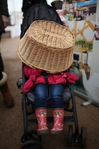 Girl hiding under basket in her pushchair, Steve Watts