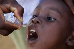 "A child in the village of Azuretti, Cote d'Ivoire, receives polio vaccine during a National Immunization Day, 27 April 2013. Find the story in ""The Rotarian,"" October 2013, pages 45-51."
