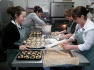 Many hands making extra mince pies